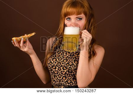 sexy young girl with pizza and beer isolated on brown background