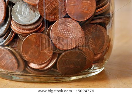 glass jar filled with American coins.  Extreme closeup ideal as background