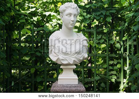 Antique Bust At The Green Fence