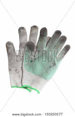 a pair of torn gloves. Gloves in the ground