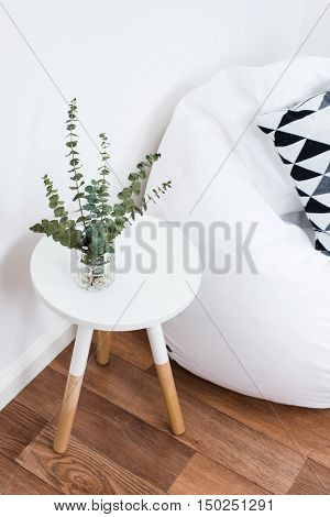 Scandinavian home interior decoration, simple decor objects and bean bag chair, minimalist white room