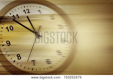 Blurred clock on brown background
