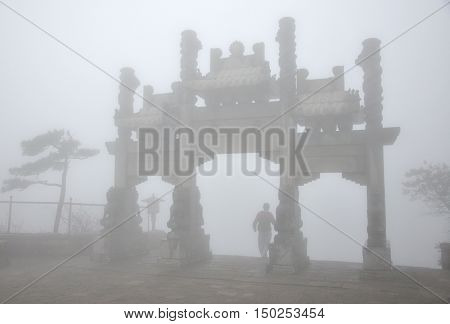 The sky gate on top of Mount Tai or Taishan on a foggy day in Shandong Province.