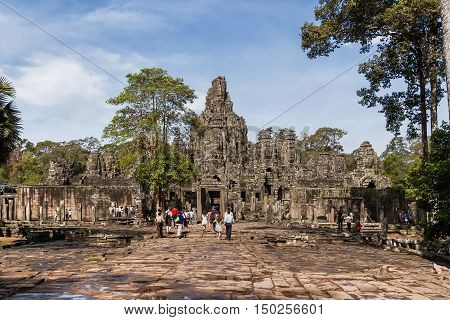 Tourists in Angkor Thom. Angkor Wat Siem Reap Cambodia. UNESCO World Heritage Site.