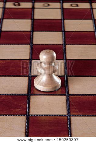 White pawn chess piece isolated on a chessboard