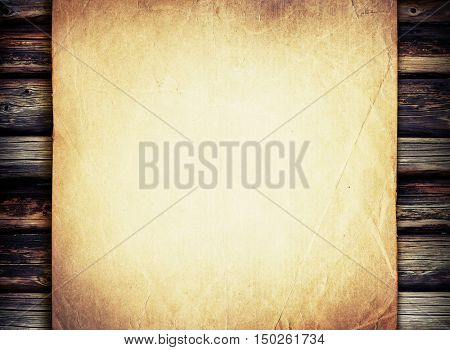 Grunge beige paper on old weathered wood lumber background. Abstract background for vintage designs.