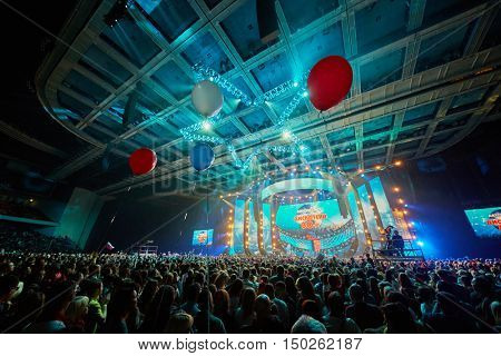 MOSCOW, RUSSIA - NOV 28, 2015: Crowd of people enjoy Disco 80 concert show by Autoradio in Olimpiyskiy sports complex.