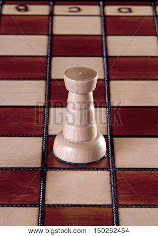 White Rook chess piece isolated on a chessboard