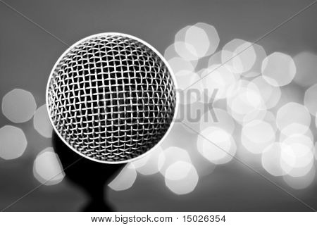 Black and white abstract image of microphone with lights in background. Macro with extremely shallow dof.