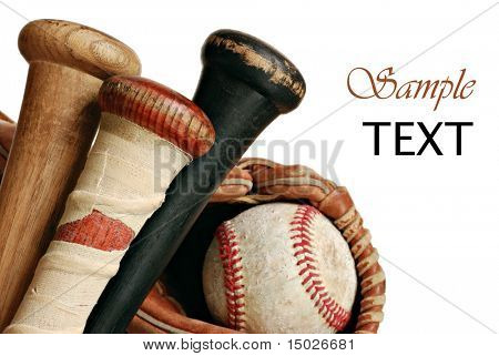 Wooden baseball bats with ball and glove on white background with copy space.  Macro with shallow dof.  Focus on taped handle.