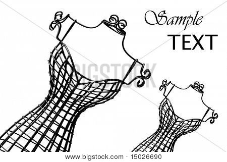 Miniature wrought iron dress forms on white background with copy space.  Macro image in black and white.