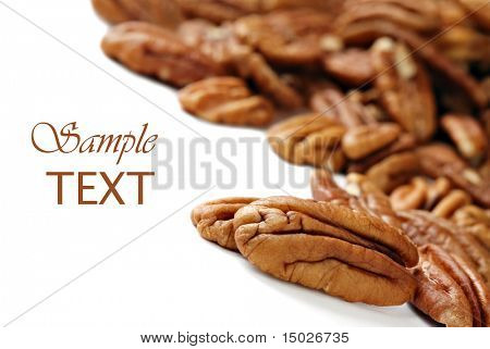 Pecan halves on white background with copy space.  Macro with extremely shallow dof.