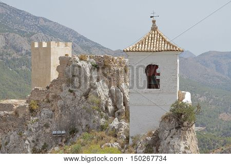 landscape of guadalest with the castle tower and the bell tower of the village