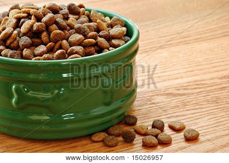 Healthy dog food in bowl on wood background with copy space.  Macro with shallow dof.