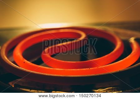 heated red-electric spiral Photo close-up in a dark room
