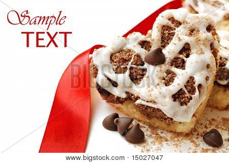 Heart shaped chocolate chip cinnamon coffee cake on white background with copy space.  Macro with shallow dof.