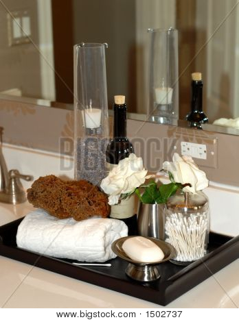 Toiletries And Bath Items On Bathroom Vanity