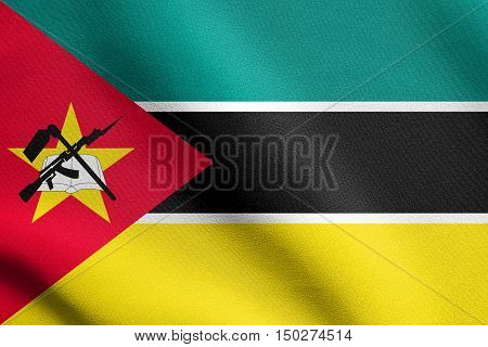 Mozambican national official flag. African patriotic symbol banner element background. Accurate dimensions. Correct size colors. Flag of Mozambique waving in the wind with detailed fabric texture, 3d illustration