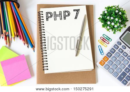 PHP 7 text message on white paper and office supplies, pen, paper note, on white desk , copy space / business concept / view from above, top view