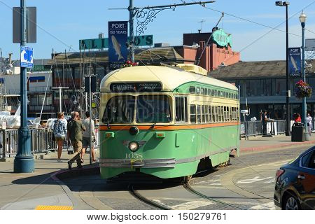 SAN FRANCISCO - MARCH 14: F-line Antique PCC streetcar No.1058 Chicago in Fisherman's Wharf on March 14th, 2014 in San Francisco, California, USA.