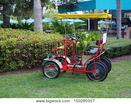 two person pedal surrey sitting empty at a resort