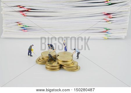 Pile Document And Gold Coins With Miniature People