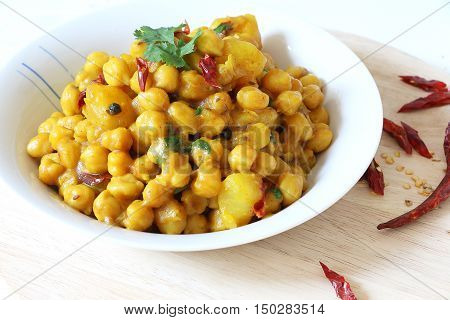 Indian, Pakistani, Nepali cuisine. Spicy chickpeas curry with potato