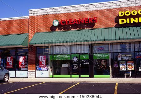 PLAINFIELD, ILLINOIS / UNITED STATES - SEPTEMBER 19, 2016: One may have one's clothes cleaned at the Perfect Fit Cleaners, in a Plainfield strip mall.