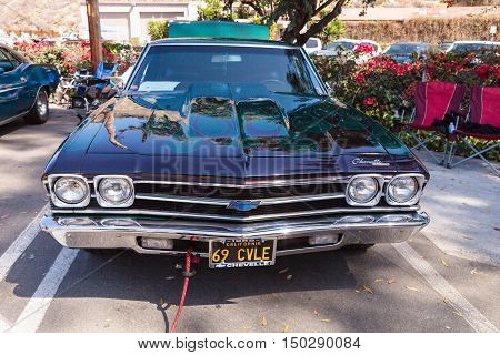 Green and blue 1969 Chevy Chevelle owned by John Pettinato and displayed at the Rotary Club of Laguna Beach 2016 Classic Car Show. Editorial use.