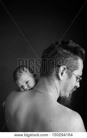 Portrait of a father and newborn daughter