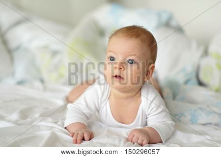 Four months old baby with blue eyes