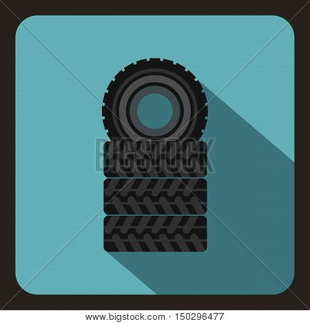 Pile of black tires icon in flat style on a baby blue background vector illustration