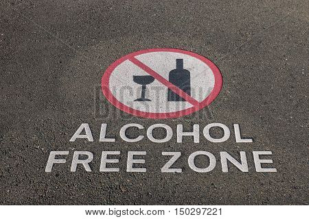closeup of alcohol free zone sign on pavement