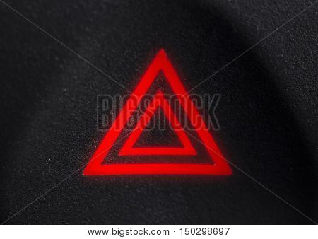 The symbol of an emergency stop of the car lights on a black background