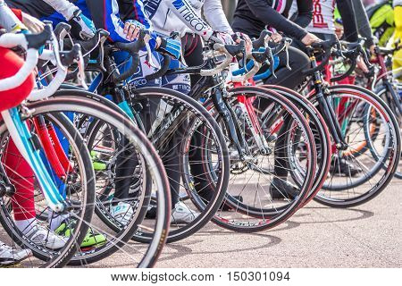 Gomel Belarus - April 10 2016: Close-up of bicycle wheels on the start after opening the bicycling season 2016 in Gomel on Lenin Square