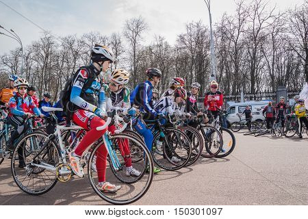 Gomel Belarus - April 10 2016: Young cyclists athletes prepare for a bike ride in Gomel on Lenin Square