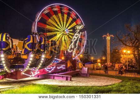 Gomel Belarus - April 17 2016: Attraction with the backlight at night time amusement park