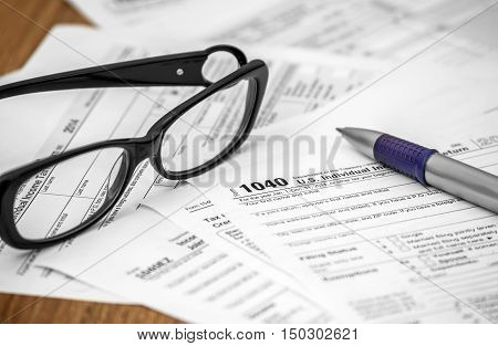 US tax form 1040 with pen and glasses