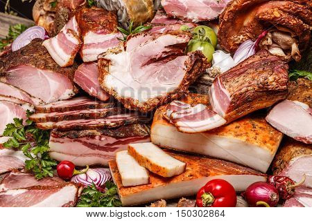 Smoked pork meat products background, studio shot