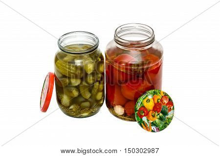 marinated tomatoes and pickled cucumbers in glass jars isolated on white