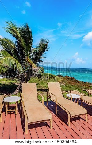 Loungers on the deck by the seafront Tobago Caribbean