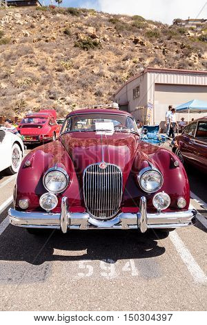 Laguna Beach, CA, USA - October 2, 2016: Red 1958 Jaguar XK 150 FHC owned by Frank Gauer and displayed at the Rotary Club of Laguna Beach 2016 Classic Car Show. Editorial use.