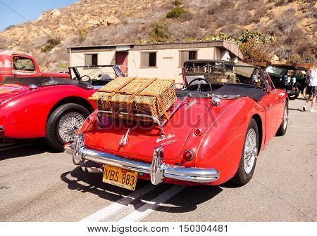 Laguna Beach, CA, USA - October 2, 2016: Red 1961 Austin Healey 3000 owned by Andy Nelson and displayed at the Rotary Club of Laguna Beach 2016 Classic Car Show. Editorial use.