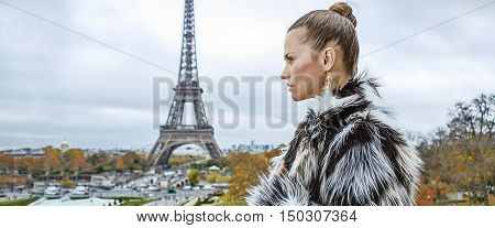 Woman In Front Of Eiffel Tower In Paris Looking Into Distance