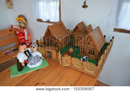 Court Model Cossack Family. Fence With Houses Inside The Fence Of The Estate Owners And Dolls.