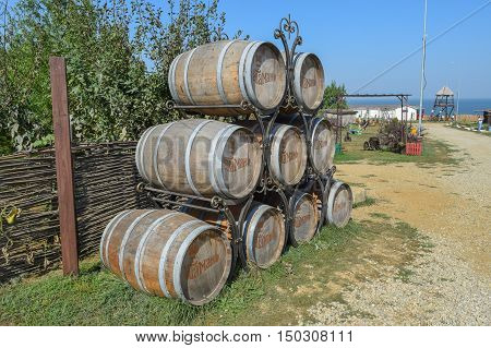 Stacked Wine Barrels. Decoration Of The Barrels In The Village Ataman.