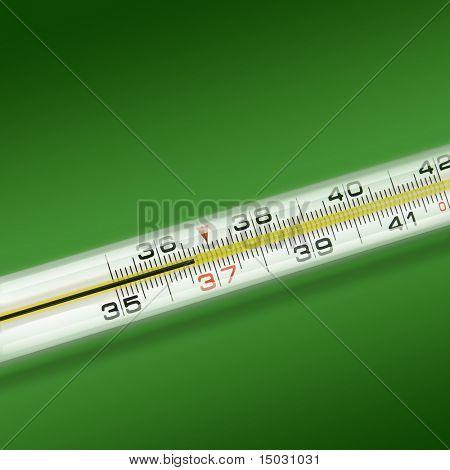 close-up Thermometer auf grünem Hintergrund
