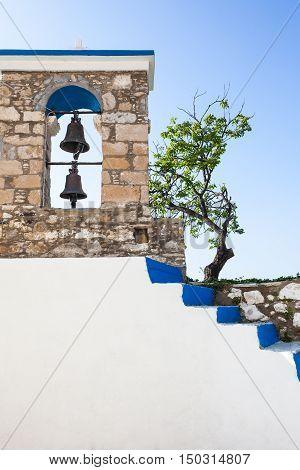 Church belfry and steps in Kos island Greece