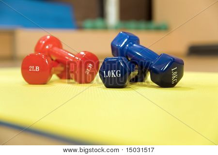 Red and blue dumbbells