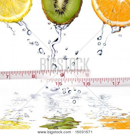 fresh water drops on fruits with measure isolated on white